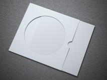 Άσπρος φάκελος του CD με το φύλλο εγγράφου Στοκ Φωτογραφίες