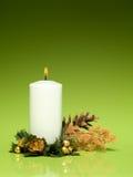 Άσπρο καίγοντας κερί Χριστουγέννων Στοκ Εικόνα