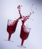 άσπρο κρασί παφλασμών ανασκόπησης κόκκινο Στοκ Εικόνα