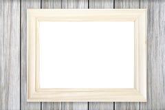 Άσπρο ξύλινο πλαίσιο εικόνων στον ξύλινο τοίχο στοκ φωτογραφία με δικαίωμα ελεύθερης χρήσης