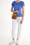 Άσπρο παντελόνι και καφετί πορτοφόλι Στοκ φωτογραφίες με δικαίωμα ελεύθερης χρήσης