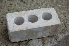 Άσπρο τούβλο για τις οικοδομές στο συγκεκριμένο slab_ Στοκ Εικόνα