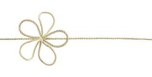 Άσπρο τόξο σχοινιών βαμβακιού στη μορφή λουλουδιών Στοκ Εικόνες