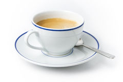 Άσπρο φλιτζάνι του καφέ στο πιάτο με το κουτάλι Στοκ εικόνα με δικαίωμα ελεύθερης χρήσης