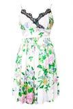 Άσπρο φόρεμα ένα floral σχέδιο που απομονώνεται με στο λευκό στοκ φωτογραφία με δικαίωμα ελεύθερης χρήσης