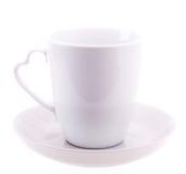 Άσπρο φλυτζάνι χρώματος στο πιάτο Στοκ Εικόνες