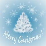 Άσπρο χριστουγεννιάτικο δέντρο σε ένα μπλε Στοκ Εικόνες