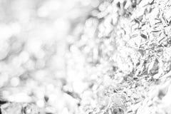 Άσπρο bokeh από τη σύσταση υποβάθρου εγγράφου φύλλων αλουμινίου Στοκ εικόνα με δικαίωμα ελεύθερης χρήσης