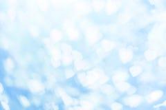 Άσπρο bokeh στην μπλε ανασκόπηση Στοκ Εικόνα