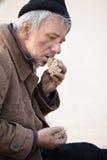 Άστεγος και πεινασμένος. Στοκ Φωτογραφία