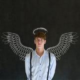 Άτομο επενδυτών επιχειρησιακού αγγέλου με τα φτερά και το φωτοστέφανο κιμωλίας Στοκ φωτογραφία με δικαίωμα ελεύθερης χρήσης