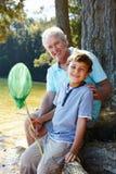Άτομο και αγόρι που αλιεύουν από κοινού Στοκ Εικόνα