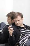Άτομο και τηλέφωνο Στοκ Φωτογραφίες