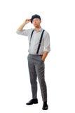 άτομο ΚΑΠ που φορά τις νεολαίες Στοκ Εικόνες