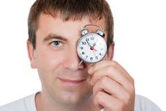 Άτομο με ένα ρολόι συναγερμών Στοκ Εικόνες