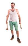 Άτομο με ένα τσεκούρι και ένα σφυρί Στοκ φωτογραφία με δικαίωμα ελεύθερης χρήσης