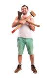 Άτομο με ένα τσεκούρι και ένα σφυρί Στοκ Εικόνες