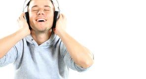 Άτομο με τα ακουστικά που απομονώνεται στο λευκό. Στοκ φωτογραφία με δικαίωμα ελεύθερης χρήσης