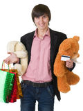 Άτομο με τα δώρα και την πιστωτική κάρτα στοκ εικόνα με δικαίωμα ελεύθερης χρήσης