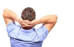 Άτομο με τα χέρια πίσω από το κεφάλι Στοκ Εικόνα