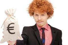 Άτομο με την ευρο- υπογεγραμμένη τσάντα Στοκ εικόνα με δικαίωμα ελεύθερης χρήσης