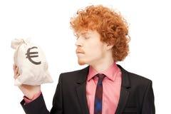Άτομο με την ευρο- υπογεγραμμένη τσάντα Στοκ εικόνες με δικαίωμα ελεύθερης χρήσης