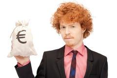 Άτομο με την ευρο- υπογεγραμμένη τσάντα Στοκ Εικόνα