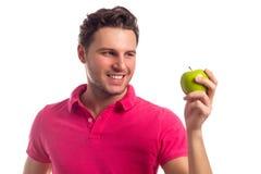 Άτομο με τη Apple που απομονώνεται στο άσπρο υπόβαθρο Στοκ φωτογραφία με δικαίωμα ελεύθερης χρήσης