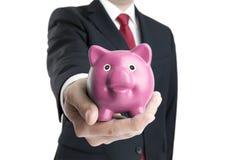 Άτομο με τη piggy τράπεζα διαθέσιμη Στοκ Φωτογραφίες