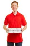Άτομο με τις πίτσες ως άτομο παράδοσης Στοκ φωτογραφία με δικαίωμα ελεύθερης χρήσης