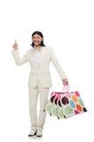Άτομο με τις τσάντες αγορών που απομονώνεται στο λευκό Στοκ Εικόνες