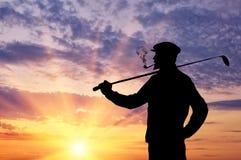 Άτομο με το παίζοντας γκολφ λεσχών Στοκ Εικόνες
