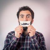 Άτομο με το πλαστό έγγραφο moustaches Στοκ Εικόνες