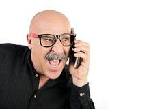 Άτομο με το mustache που μιλά στο κινητό τηλέφωνό του Στοκ Φωτογραφία