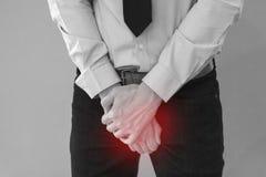 Άτομο που έχει ένα πρόβλημα με το πέος του με το κόκκινο σημείο Στοκ Φωτογραφίες