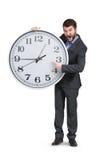Άτομο που δείχνει στο ρολόι Στοκ φωτογραφία με δικαίωμα ελεύθερης χρήσης