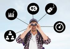 Άτομο που κοιτάζει μέσω των διοπτρών με τα επιχειρησιακά εικονίδια Στοκ Εικόνα