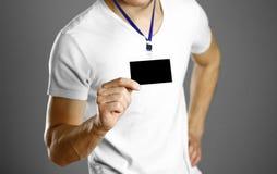 Άτομο που κρατά ένα διακριτικό κλείστε επάνω Απομονωμένο υπόβαθρο στοκ φωτογραφία με δικαίωμα ελεύθερης χρήσης