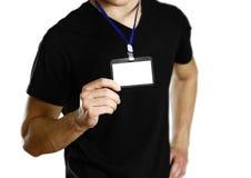 Άτομο που κρατά ένα διακριτικό κλείστε επάνω Απομονωμένο υπόβαθρο στοκ εικόνες