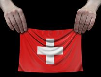 Άτομο που κρατά την ελβετική σημαία Στοκ Εικόνες