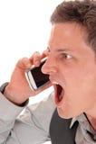 Άτομο που κραυγάζει στο τηλέφωνο κυττάρων Στοκ Φωτογραφία