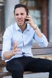 Άτομο που κραυγάζει στο τηλέφωνο Στοκ Φωτογραφία