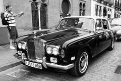 Άτομο που παίρνει μια φωτογραφία ενός limousine. Στοκ Φωτογραφία