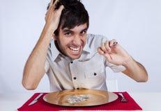 Άτομο που τρώει λίγο τραπεζογραμμάτιο δολαρίων Στοκ Εικόνα