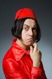 Άτομο που φορά το κόκκινο καπέλο του Fez Στοκ φωτογραφίες με δικαίωμα ελεύθερης χρήσης