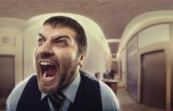 Άτομο που φωνάζει στο γραφείο Στοκ Φωτογραφίες