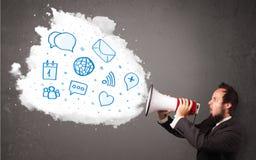 Άτομο που φωνάζει στο μεγάφωνο και τα σύγχρονα μπλε εικονίδια και τα σύμβολα Στοκ Φωτογραφία