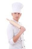 Άτομο σε ομοιόμορφο αρχιμαγείρων με την ξύλινη κυλώντας καρφίτσα ψησίματος που απομονώνεται στο W Στοκ Εικόνα