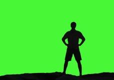 Άτομο σκιαγραφιών στο ανοικτό πράσινο κλίμα Στοκ φωτογραφία με δικαίωμα ελεύθερης χρήσης