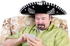 Άτομο σομπρέρο σε κινητό Στοκ εικόνες με δικαίωμα ελεύθερης χρήσης